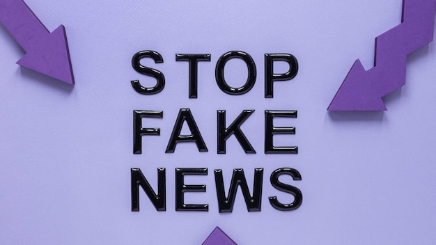 Arrows pointing at stop fake news