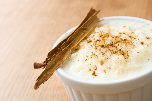 Arroz con leche rice pudding with cinnamon on wood