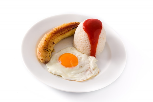 Arroz a la cubana typical cuban rice with fried banana and fried egg on a plate