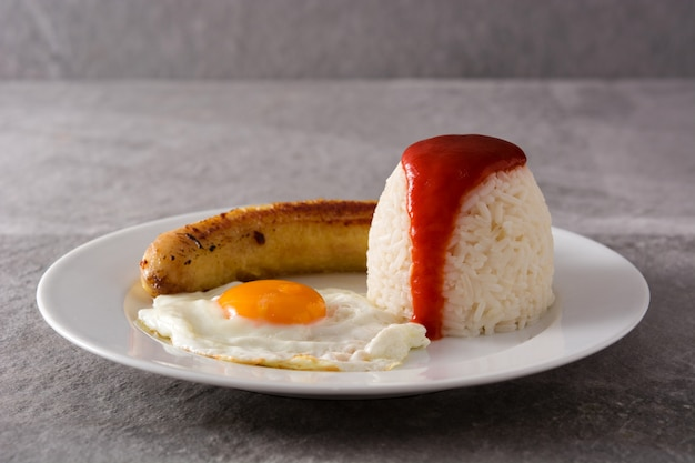 Arroz a la cubana typical cuban rice with fried banana and fried egg