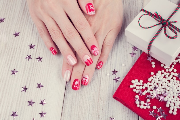 Art christmas manicure, red and white color