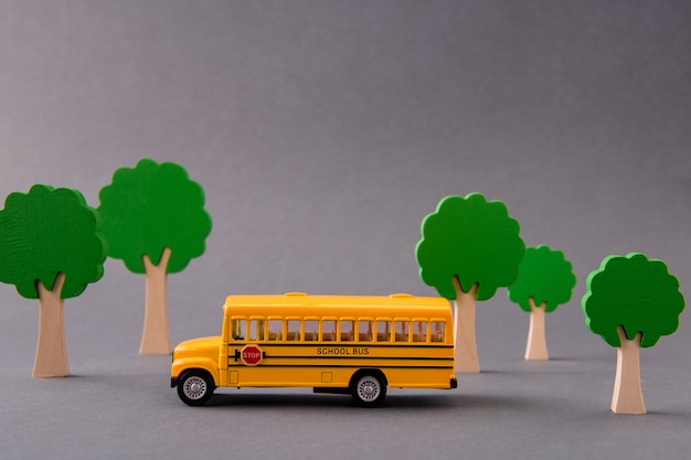 Art design picture of school bus taking kids from home to primary school