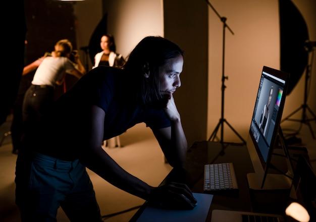 Art director checking photos on a monitor