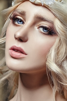 Art fashion blonde girl long eyelashes clear skin