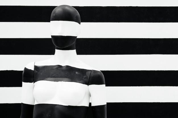 Art mannequin black and white stripes, on striped with black and white stripes.
