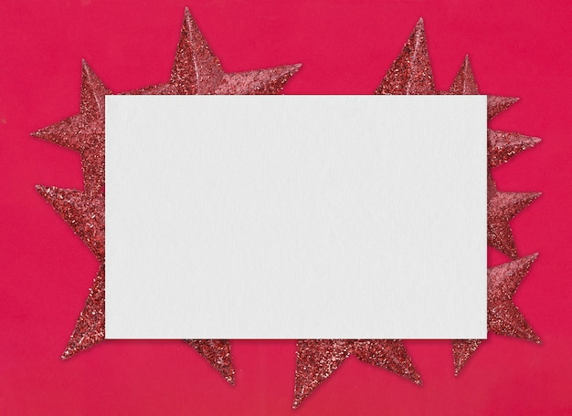 Art paper and red star on the red background and have copy space for new year and christmas concept