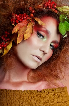 Art portrait of women autumn in hair, vivid makeup