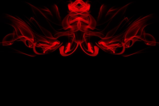 Art of red smoke abstract on black background, fire . copy space