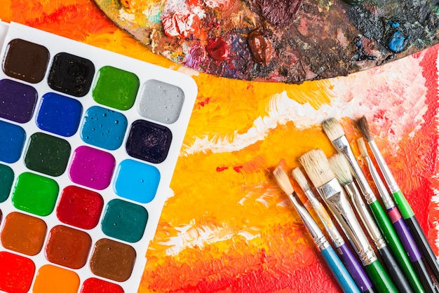 Art supplies on abstract painting