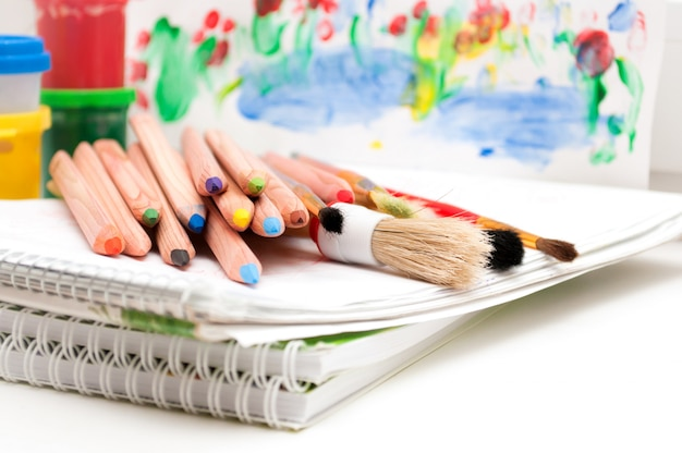 Art supplies with pencils and brushes