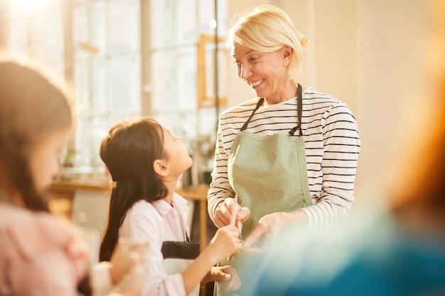 Art teacher working with children