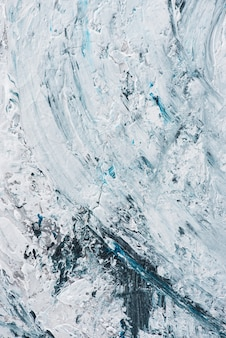 Art texture with light blue and white brush strokes on oil painting