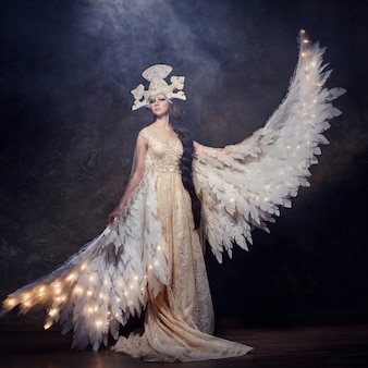 Art woman angel with wings in luxurious long dress