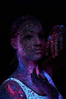 Art woman cosmos in ultraviolet light