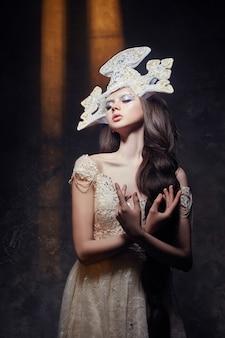 Art woman with a long braid luxurious long dress