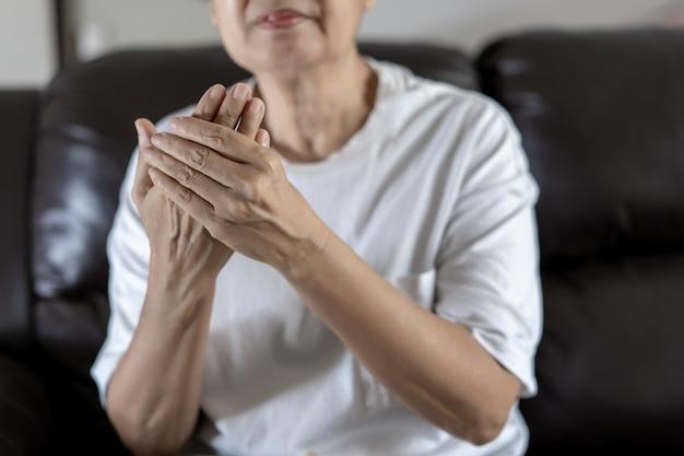 Arthritis old person and elderly woman female suffering osteoarthritis
