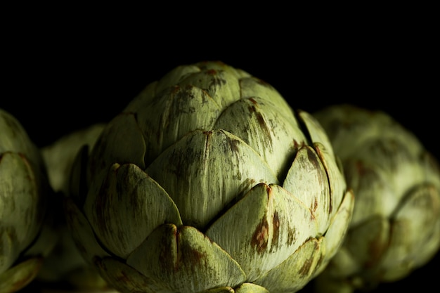 Artichokes on black background