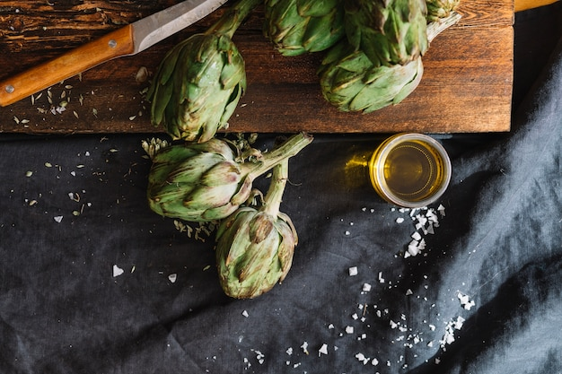 Artichokes and glass of oil