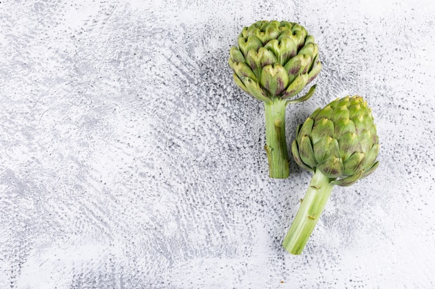 Artichokes on a light gray . side view. free space for your text