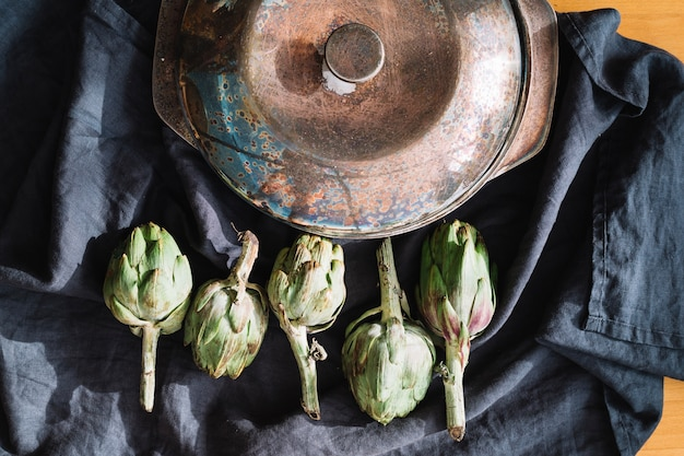 Artichokes near saucepan