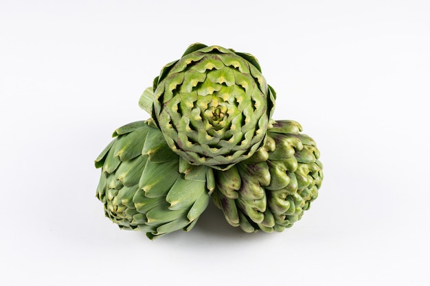 Artichokes with high angle view on a white