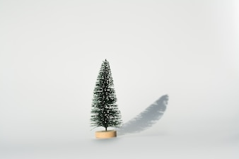 Artificial Christmas tree with shadow on white background using for Christmas decoration.