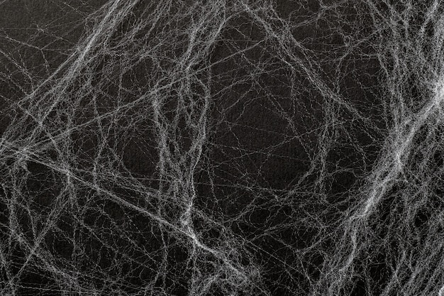 Artificial cobweb or spaider web on a black background. abstract background. top view,  happy halloween