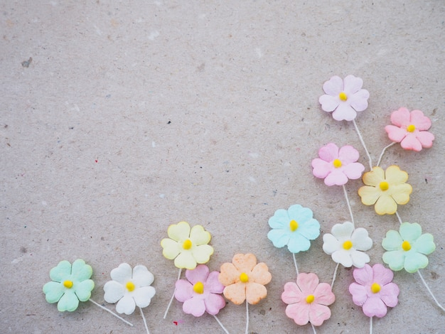Artificial flower on recycled paper background