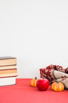 Artificial fruits and blanket near books