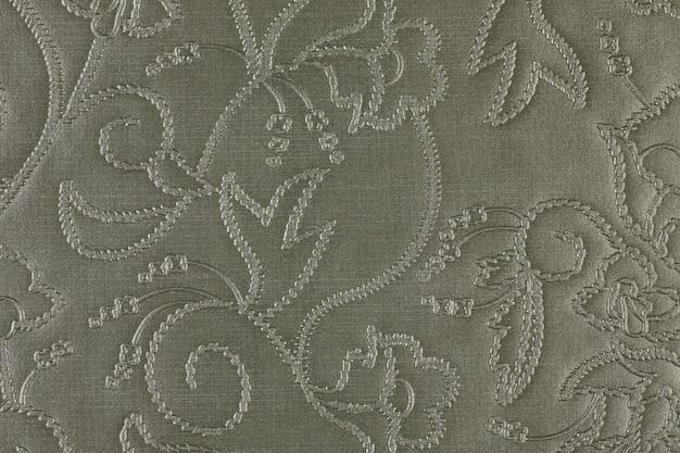 人工灰色の織り目加工の革の背景の合成クローズアップマクロ
