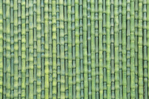 Artificial green bamboo fence as texture background