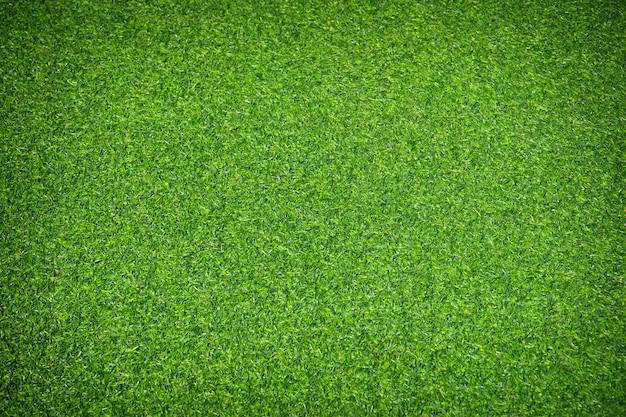 Artificial green grass texture background.