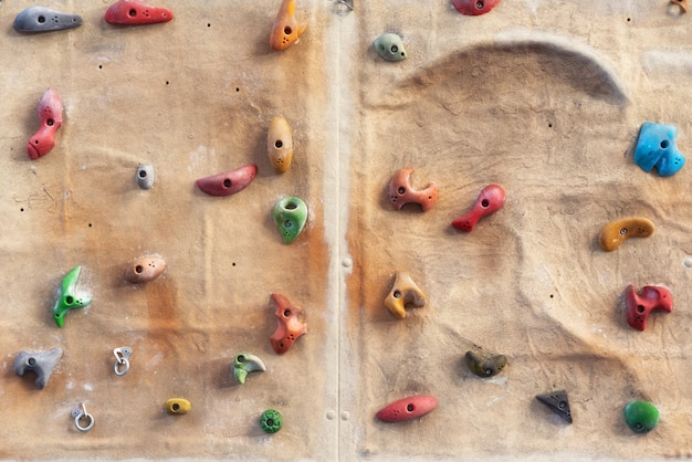 Artificial indoors climbing wall background.