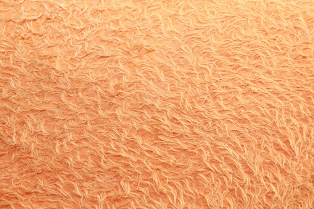 Artificial orange fur background.