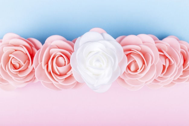 Artificial roses on a colored background