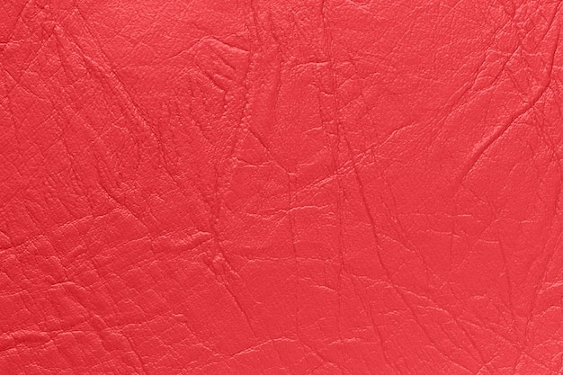 Artificial skin in red color. background, texture.