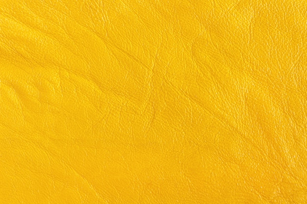 Artificial skin in yellow color. background, texture.