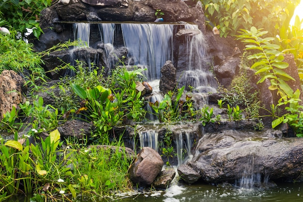 Artificial small water fall in the park garden home green space decoration.