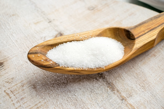 Artificial sweeteners and sugar substitutes in wooden spoon