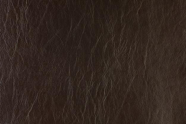 Искусственная текстурированная кожа фон синтетика крупным планом макрос