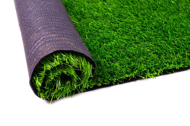 Artificial turf, green grass, roll coverings for sports fields, lawn isolated