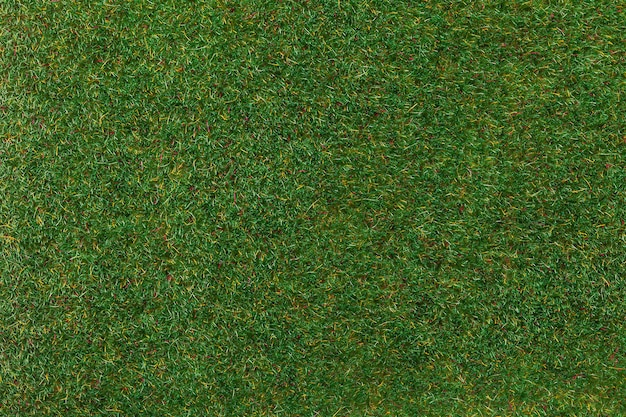 Artificial turf for sport field and decorating the yard, macro background. texture of green grass carpet, backdrop.