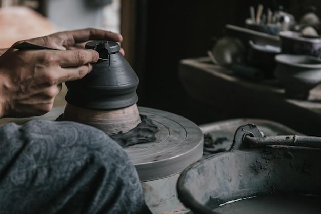 Artisan potter making art pot