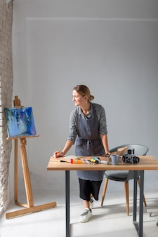Artisan in studio with painting