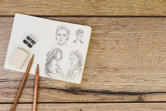 Artist concept with notebook and pencils