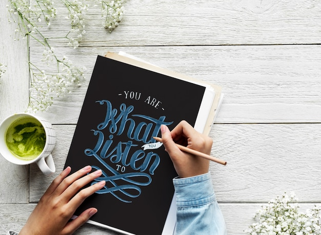 An artist creating hand lettering artwork from motivation quote