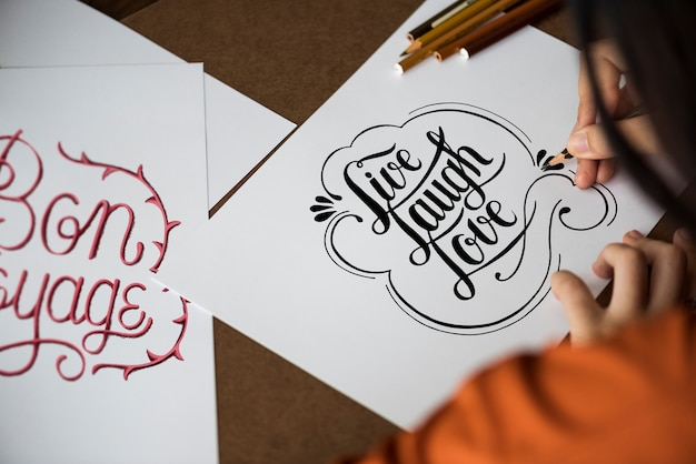 An artist creating hand lettering artwork