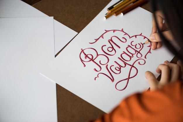 An artist creating hand lettering artwork