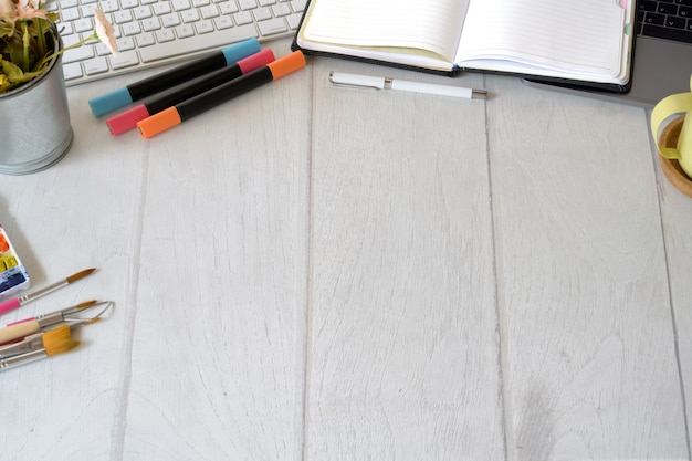 Artist designer workspace with creative supplies and copy space