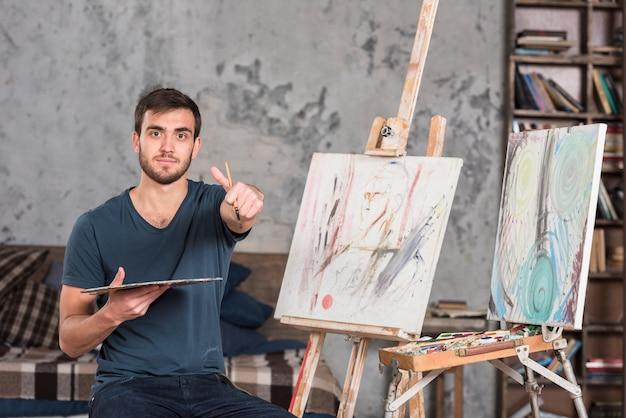 Artist doing thumbs up